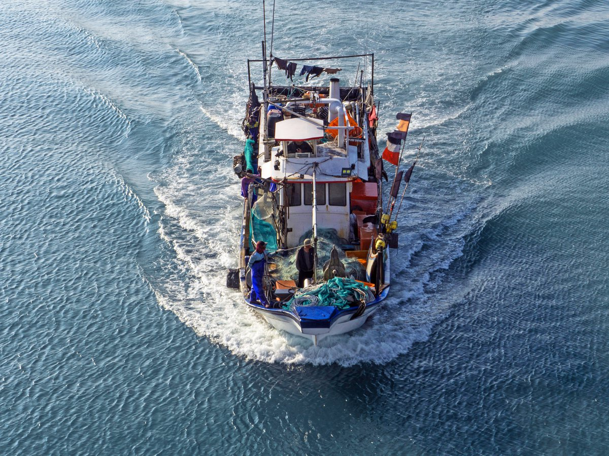 Fishing boat at sea.